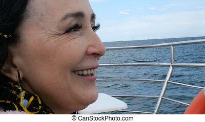 Happy beautiful senior woman of Caucasian or Asian...