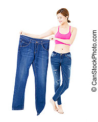happy beautiful slim young woman with big jeans
