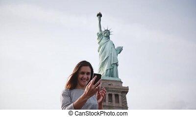 Happy beautiful smiling Caucasian tourist girl making a...
