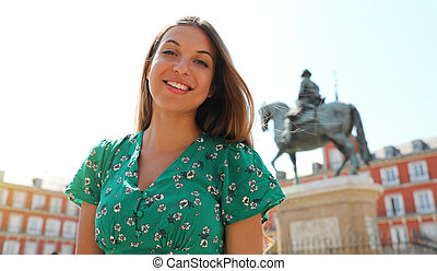 Happy beautiful smiling woman in Plaza Mayor square, Madrid, Spain