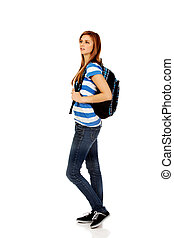 Happy beautiful teen woman with backpack