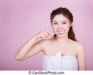 happy beautiful woman brushing her teeth