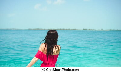 Happy beautiful woman have fun on tropical seashore. Young girl enjoy her tropical vacation exotic island