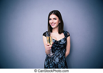 Happy beautiful woman holding glass of champagne