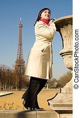Happy beautiful woman in Paris, enjoying warm spring day