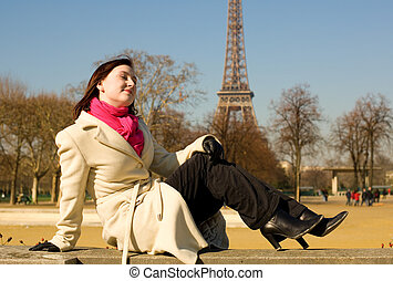 Happy beautiful woman in Paris, relaxing