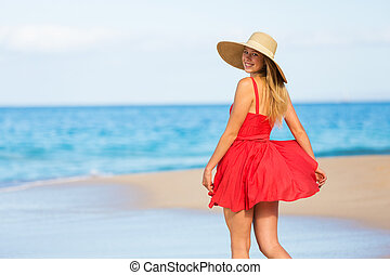 Happy Beautiful Woman in Red Dress on the Beach