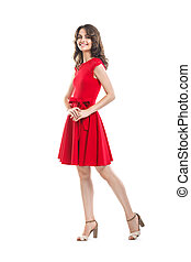 Happy beautiful woman in red dress isolated on white background