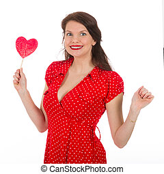 Happy beautiful woman in red dress with colorful lollipop