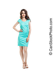 Happy beautiful woman in turquoise cocktail dress posing isolated on white background