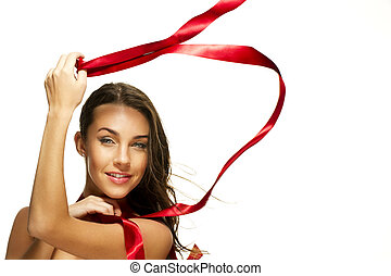 happy beautiful woman playing with a red ribbon on white background