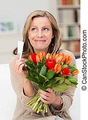 Happy beautiful woman sitting romanticising