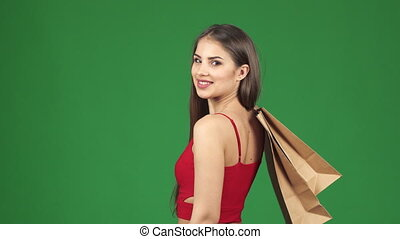 Happy beautiful woman smiling holding shopping bags showing thumbs up