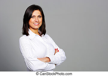 Happy beautiful woman standing with arms holding