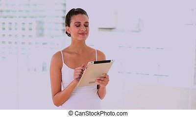 Happy beautiful woman using laptop