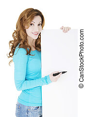 Happy beautiful woman writing with a pen on blank board.
