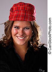 Happy beautiful Woman,with a hat, studio shot