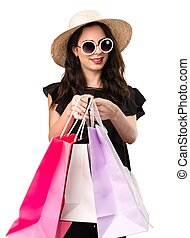 Happy beautiful young girl  with shopping bag