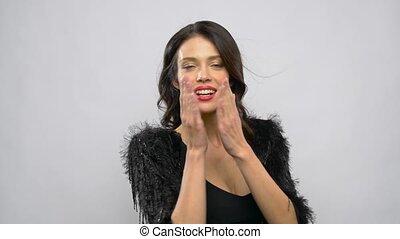 happy beautiful young woman blowing air kisses
