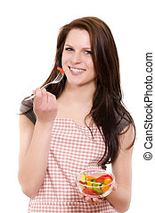 happy beautiful young woman eating salad on white background