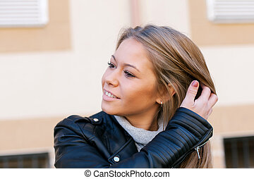 Happy beautiful young woman on street