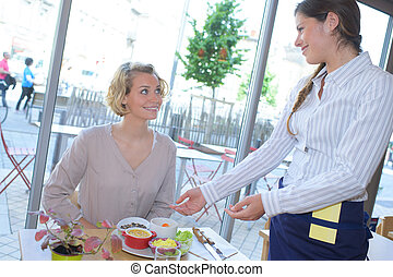 happy beautiful young woman sitting in cafe