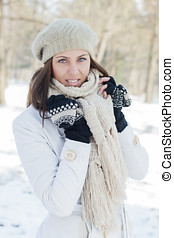 Happy Beautiful Young Woman Winter Saeson in the park....