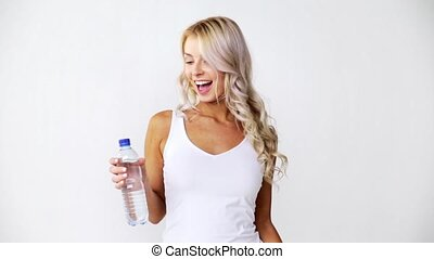happy beautiful young woman with bottle of water