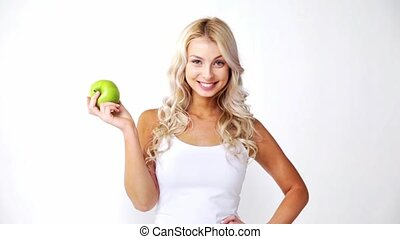 happy beautiful young woman with green apple - healthy food,...