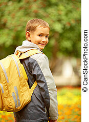Happy beginner - Portrait of happy lad with rucksack on back...