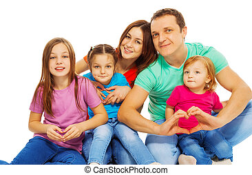 Happy big young family in multicolored tees