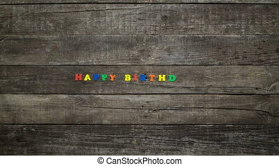 Happy Birthday animation on wooden boards