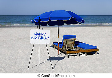 Happy Birthday Beach Sign - A whiteboard on the beach with...