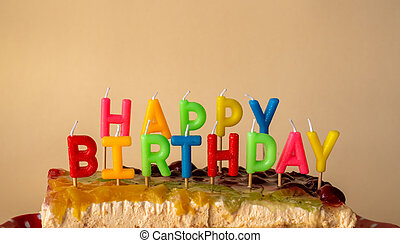 Happy birthday cake on yellow background with candles