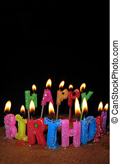 Happy Birthday Candles and Cake - Lighted candles on a...