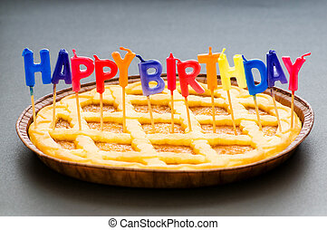 Happy birthday candles in the pie