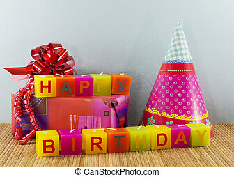 happy birthday candles with present