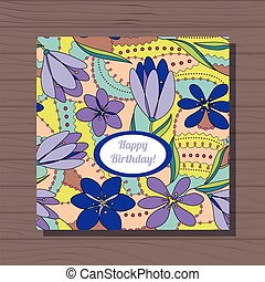 Happy birthday card with crocuses on wooden background