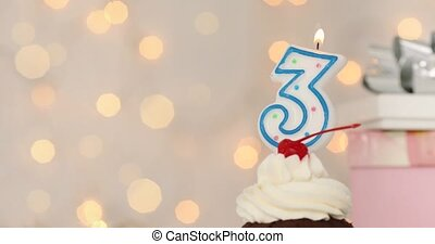 Happy birthday cup cake with 3 candle with cream background - Birthday celebration background