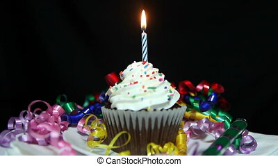 Happy Birthday Cupcake With Candles Being Lit and Burning Out. Lapse between lighting and burning for Birthday Message or Music