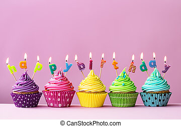 Happy birthday cupcakes - Cupcakes with candles spelling the...