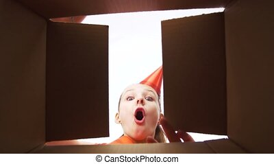 happy birthday girl in party hat opening gift box - presents...