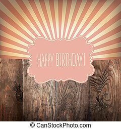Happy Birthday greeting card with sunrays and vintage label. On wooden background