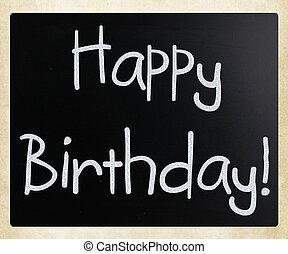 """""""Happy Birthday"""" handwritten with white chalk on a blackboard"""