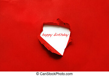 happy birthday - Happy birthday written on a hole on a red...