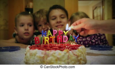 Happy Birthday - Light up the candles on the cake and there...
