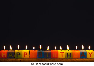 Happy birthday lit candles
