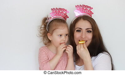 Happy birthday. Mother and daughter smile, have fun, laugh...