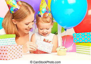 happy birthday. mother giving  gift to his little daughter with balloons