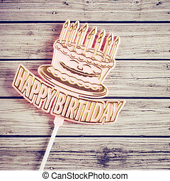 Happy birthday on wooden background with retro filter effect